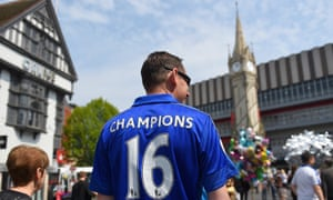 A Leicester City fan takes part in title celebrations before the home game against Everton in May 2016, where Claudio Ranieri lifted the Premier League trophy.
