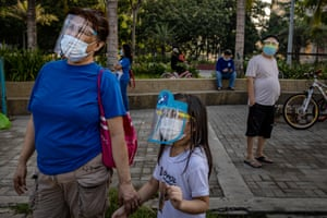 Filipinos wearing facemasks and face shields to protect against coronavirus visit Manila Baywalk on 19 September, 2020 in Manila, Philippines.