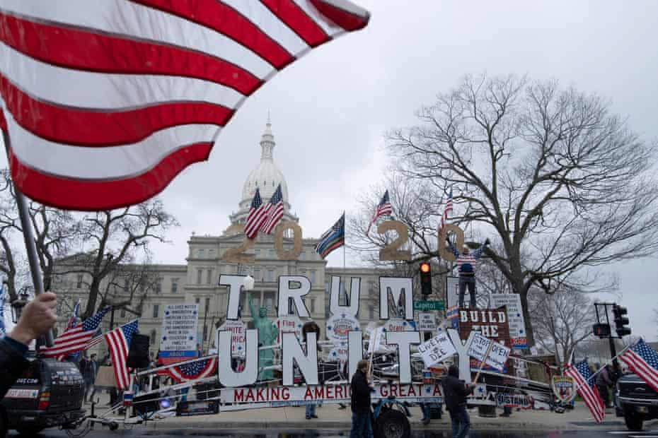 Protesters outside the state capitol in Lansing. The Michigan protest has sparked copycat rallies across the US.