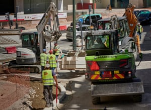 Workers are helped by machinery while remodeling a sidewalk near Praça Espanha on 2 September, 2020 in Lisbon, Portugal. The coronavirus pandemic has not stopped construction activities in Portugal.