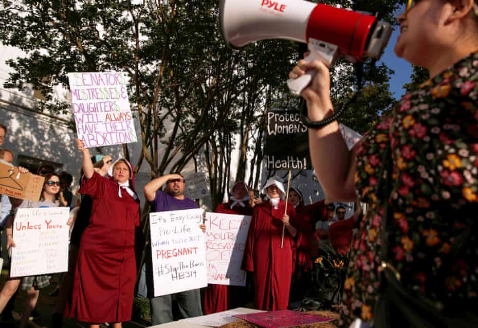 Pro-choice supporters protest in front of the Alabama state house as the state senate votes on the strictest anti-abortion bill in the US.