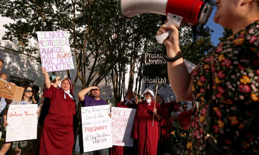Pro-choice supporters protest in front of the Alabama State House.