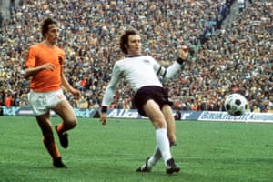 West Germany's Franz Beckenbauer gets to the ball ahead of Johan Cruyff