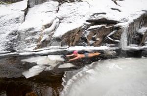 Glen Banchor, UKAlice Goodridge swims the frozen waters of the River Calder in Glen Banchor in the Cairngorms National Park