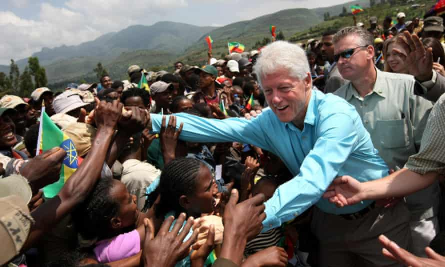 Bill Clinton greets villagers after he visited the Godino Health Center on 1 August 2008 in Debre Zeit, Ethiopia.
