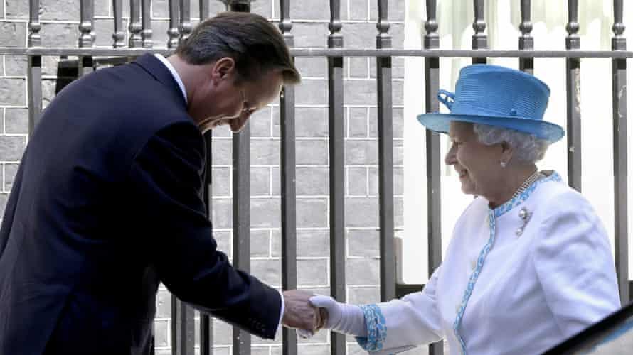 David Cameron welcomes Queen Elizabeth II to Downing Street.