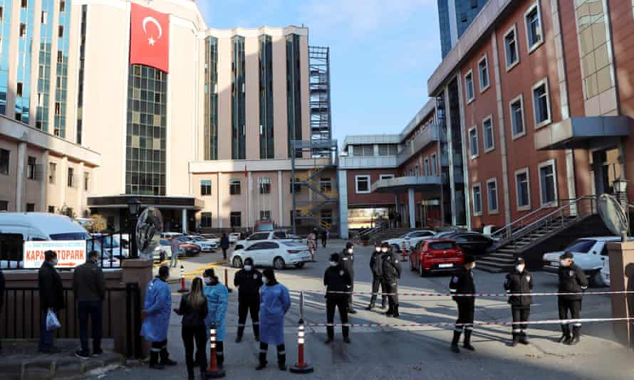 Police and security personnel stand guard outside the Sanko University hospital in Gaziantep after the incident.