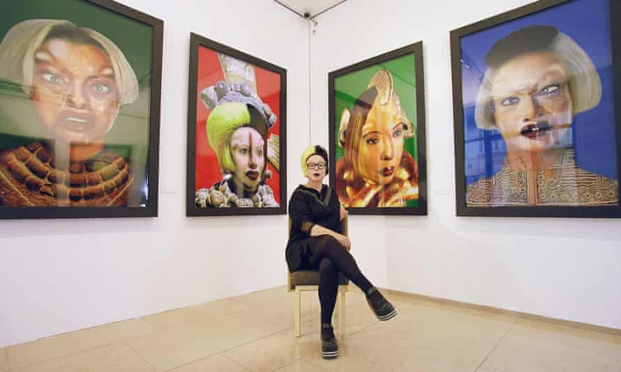 ORLAN, photographed in front of her surgery-inspired self-portraits in 1999.