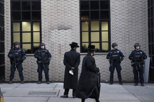 New York City police guarding a Brooklyn synagogue after the attack in nearby Jersey City on Tuesday.
