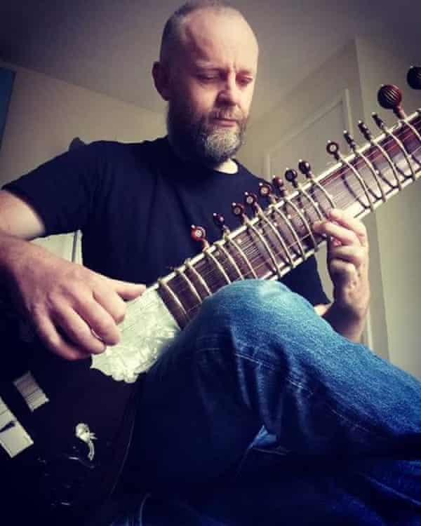 John Lancaster playing his sitar