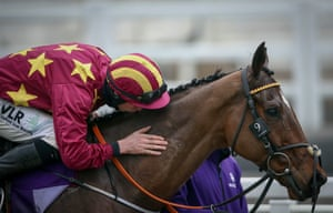 Minella Indo is congratulated with a kiss from Jack Kennedy.