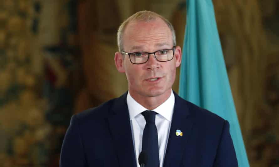 Simon Coveney addresses the media in Prague