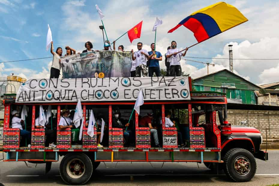 Former Farc guerrilla fighters ride in 'chivas' – local transport vehicles – towards Bogotá in Medellín, Colombia, in October 2020, demanding peace accords to be respected.