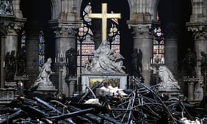 The altar surrounded by charred debris inside the Notre Dame Cathedral in Paris