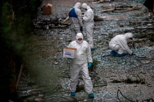 Greek police experts search for evidence outside the SKAI TV building.