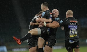 Exeter Chiefs captain Joe Simmonds is lifted by Jack Yeandle after he scored a last minute penalty.