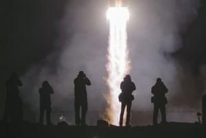 Baikonur, KazakhstanSoyuz-FG rocket booster with Soyuz MS-12 space ship carrying U.S. astronauts Christina Hammock Koch, Nick Hague, and Russian cosmonaut Alexey Ovchinin. blasts off.