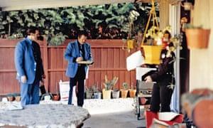 Investigators process the Rancho Cordova backyard where two victims, Brian and Katie Maggiore, were found shot dead in 1978.