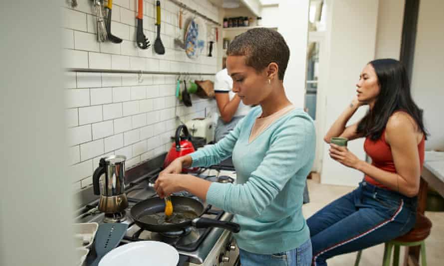 Woman frying egg