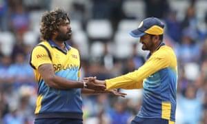 Sri Lanka's Lasith Malinga, left, celebrates after the dismissal of India's K.L. Rahul.
