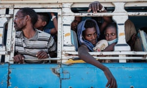 Refugees are transferred by bus from the Hamdayet camp to another Sudanese border camp at Um Rakuba.