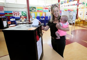Niamh Gavin holds her five-month-old daughter as she votes in Athlone, central Ireland