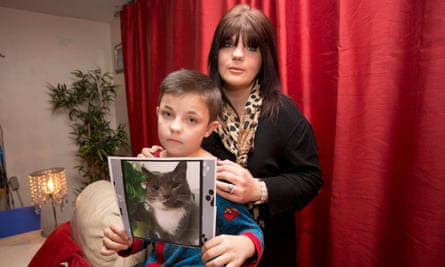 Amber Lewis and her son Liam, whose pet, Leo, was a victim of the cat killer.