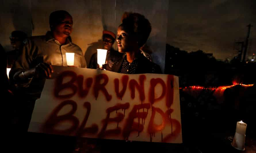 In Nairobi, Kenya, activists hold a candlelight vigil to call for peace in Burundi