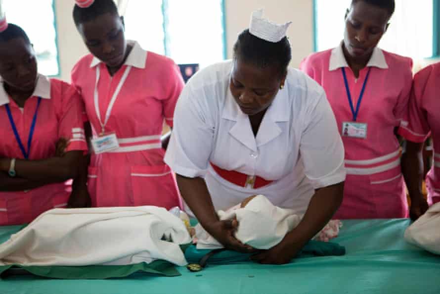 A nurse running a training session on baby resuscitation at Villa Maria nurses and midwifery school in Uganda.