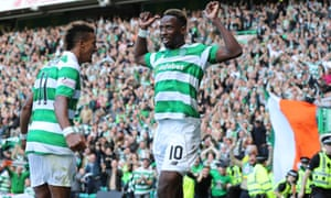 Celtic's Moussa Dembélé celebrates his second goal against Rangers with Scott Sinclair.