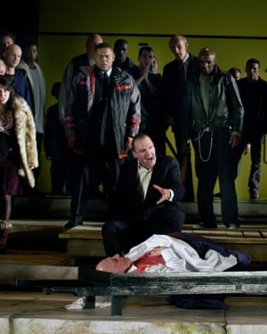 Fiennes as Mark Antony performs the funeral oration over the body of Caesar (John Shrapnel), in Shakespeare's Julius Caesar, directed by Deborah Warner, at the Barbican theatre in 2005.