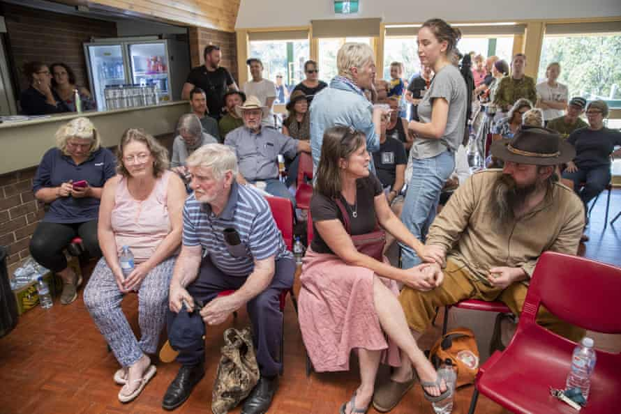 Fire evacuees congregate for a community meeting at Moriarty Park Hall in Canungra, Queensland on Sunday.