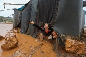 Children play in the Umm Jurn camp for the displaced after heavy rain in Syria's northern rebel-held Idlib province.