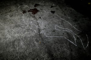 Blood and chalk mark the location where the corpse of a suspected drug pusher was found