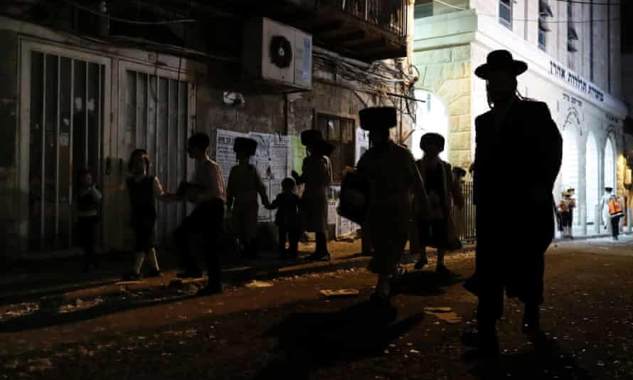 Ultra-Orthodox Jewish men walk in a street in Jerusalem