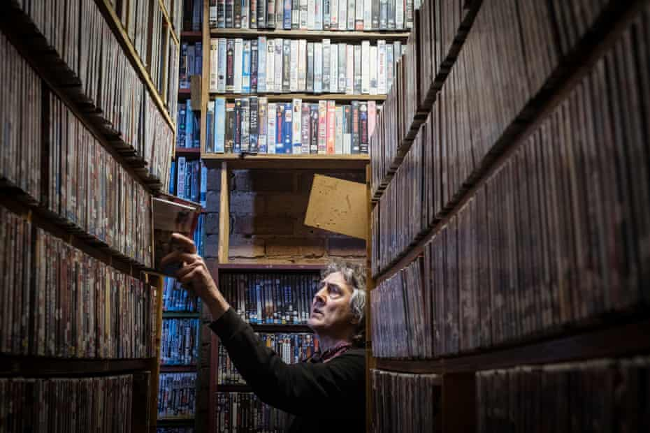 Derek puts the DVDs back in the library