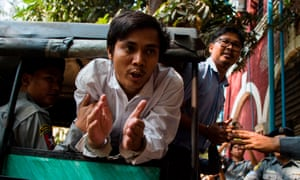 Detained Myanmar journalists Kyaw Soe Oo (C) and Wa Lone (R) have been charged under the country's official secrets act.