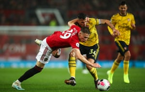 Scott McTominay of Manchester United and Arsenal's Granit Xhaka tussle for the ball at Old Trafford on Monday night.
