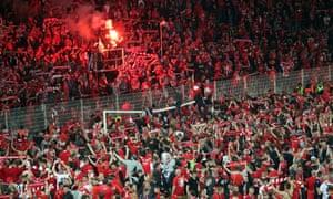 Union Berlin fans celebrate after winning the Bundesliga relegation play-off.