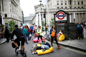 London, UKPeople relax on the road near Bank Station