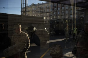 Soldiers wait with military vehicles before a rehearsal for the Independence Day military parade in Kiev