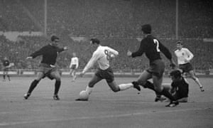 Jimmy Greaves goes on a jinking run beating two Mexican defenders, leaving one lying on the ground as he takes the ball past a third defender during England's 2-0 win over Mexico