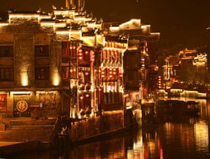Guizhou, China. Lanterns hung on buildings beside the river in Zhenyuan ancient city