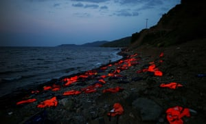 Life vests are left on the shore by refugees arriving in Lesbos in 2015.