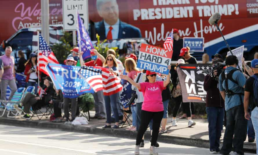 Supporters await Trump's return along the route to Mar-a-Lago in West Palm Beach, Florida, on 20 January.