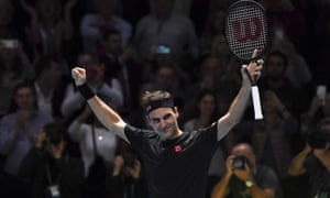 Roger Federer celebrates the winning match point against Novak Djokovic.