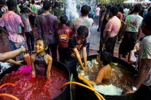 Children soak themselves in vats of coloured water as they celebrate the Holi festival in Yangon, Myanmar