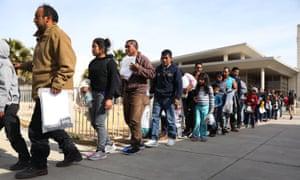 Asylum-seeking migrants arrive at a care facility in El Paso, Texas.