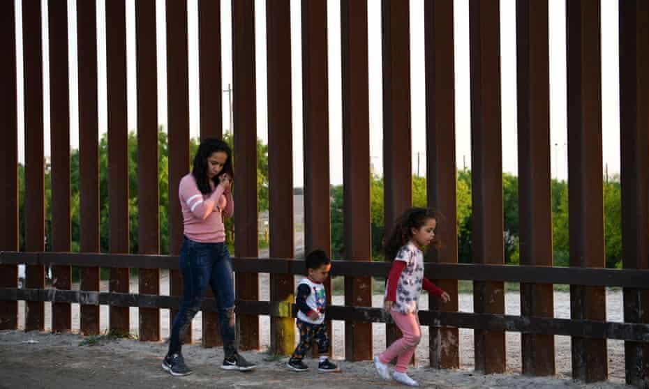 Central American migrants turn themselves in to US border patrol to seek asylum in Texas.