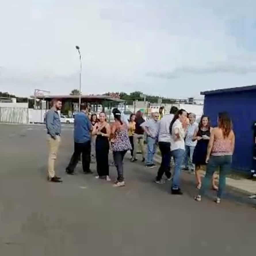 Residents gather outside during the evacuation in Noumea.